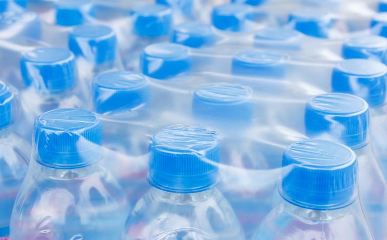 Rows of water bottles in plastic wrap